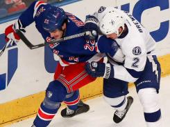 New York Rangers center Brian Boyle (22) and Tampa Bay Lightning defenseman Eric Brewer (2) battle for the puck during the first period at Madison Square Garden.