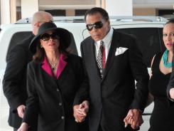 Muhammad Ali, center, and his wife, Lonnie, left, arrive for the funeral for legendary boxing trainer Angelo Dundee, at the Countryside Christian Center in Clearwater, Fla.