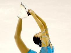 Mao Asada of Japan competes in the women's short proogram during the ISU Four Continents Figure Skating Championships at World Arena in Colorado Springs, Colorado. Asada, a two-time world champion, won the event.