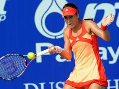 Sorana Cirstea of Romania lines up a forehand upon her approach to feat opposite Vera Zvonareva of Russia.