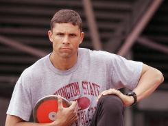 In this file photo from 2002, decathlete Dan O'Brien poses at the track facilities at Washington State University in Pullman, Wash.