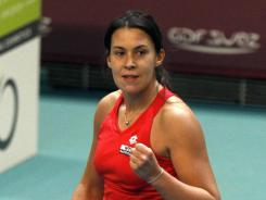 Marion Bartoli of France pumps her fist after defeating Klara Zakopalova of the Czech Republic to reach the Open GDF Suez final.