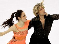 Meryl Davis and Charlie White compete in the Short Dance during the ISU Four Continents Figure Skating Championships at World Arena on Saturday in Colorado Springs. The tandem, who are defending champs at Four Continents, won the Short Dance event.