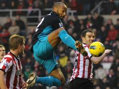 Thierry Henry goes airborne to score the game-winner in stoppage time during Arsenal's 2-1 victory over Sunderland on Saturday.