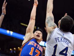 Knicks guard Jeremy Lin, left, had his worst shooting game from the field, but hit the go-ahead free throw in New York's win Saturday vs. the Timberwolves in Minneapolis.