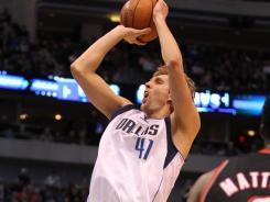 Dirk Nowitzki had 20 points and nine rebounds to lead the Mavericks to their third consecutive win.
