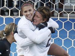 Alex Morgan, left, celebrates with Abby Wambach after one of her two goals that helped the USA defeat New Zealand for the eighth time in a row.