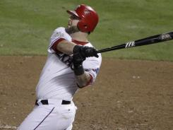 Catcher Mike Npaoli agreed to a one-year contract with the Rangers worth $9.4 million.