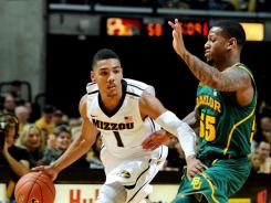 Phil Pressey scored 19 points and four of No. 4 Missouri's season-best 14 3-pointers, helping the Tigers pull away in the second half of a 72-57 victory over No. 6 Baylor on Saturday.