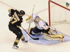Bruins center Patrice Bergeron scores the game-winning goal past Predators goalie Pekka Rinne during a shootout.