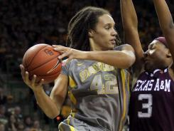 Brittney Griner (42) helped top-ranked Baylor remain unbeaten with 21 points and 10 rebounds, her 11th double-double of the season.