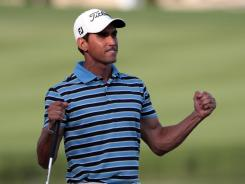 Rafael Cabrera-Bello of Spain celebrates on the 18th green during the final round of the Omega Dubai Desert Classic.