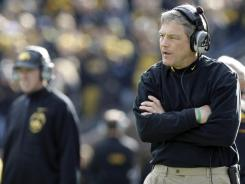 In this Nov. 12, 2011, file photo, Iowa coach Kirk Ferentz looks on during the second half of a game against Michigan State in Iowa City.