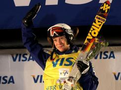 Hannah Kearney celebrates on the victory podium after winning the women's dual moguls competition during the Visa Freestyle International FIS Freestyle World Cup at Deer Valley on Feb. 4 in Park City, Utah.