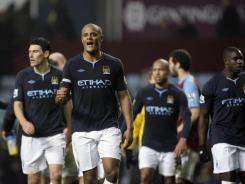 Manchester City's Vincent Kompany (center) celebrates alongside teammates after a 1-0 win over Aston Villa during their English Premier League soccer match at Villa Park Stadium, Birmingham, England, on Sunday.