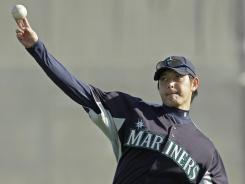 New Mariners pitcher Hisashi Iwakuma is one of the biggest story lines heading into Mariners spring training. Seattle began their preseason workouts Sunday, ahead of their exhibition trip to Iwakuma's native Japan.