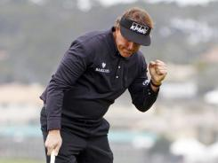 Phil Mickelson celebrates after making eagle on the sixth hole during the final round of the AT&T Pebble Beach National Pro-Am.