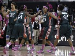 Shawnice Wilson, Sylvia Bullock, Maria Brown and Shenise Johnson react after Miami defeated Maryland 76-74.