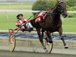 Broad Bahn driven by George Brennan, won the Hambletonian last August, and Sunday was named 3-year-old male trotter of the year.