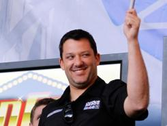 Tony Stewart, then fresh off his third Sprint Cup championship, waves during a fan event at NASCAR's season-ending championship celebration in Las Vegas.