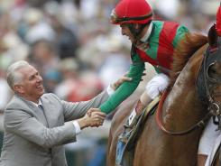 Trainer Todd Pletcher, left, congratulates John Velazquez after Velazquez rode Animal Kingdom to victory during last year's Kentucky Derby. Pletcher won his 3,000th career race Saturday.