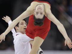 Canada's Scott Moir (left) and Tessa Virtue perform in the ice dance free dance during the Four Continents Figure Skating Championships on Sunday in Colorado Springs. Moir and Virtue won the gold medal in the ice dance.