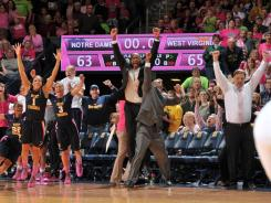 The Mountaineers celebrate after upsetting the Fighting Irish 65-63 at the Purcell Pavilion.