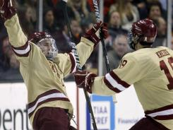 Boston College forward Pat Mullane, left, celebrates his goal with teammate Chris Kreider against Boston University during the first period on Monday night.