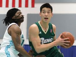 While playing for the Reno Bighorns, Jeremy Lin, right, drives to the basket during the NBA D-League Showcase against the Sioux Falls SkyForce in January.