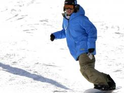 Snowboarder Kevin Pearce hit the slopes for the first time Dec. 13, 2011, in Breckenridge, Colo. It was his first time on a snowboard in nearly two years after a near-fatal fall at a halfpipe in Park City, Utah.