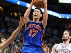 New York Knicks guard Jeremy Lin, No. 17, had to do his scoring fighting through the lane in Saturday's 100-98 victory vs. the Minnesota Timberwolves. Kevin Love, No. 42, was a big impediment, while rookie T'wolves guard Ricky Rubio, left, had the man-to-man assignment on Lin.