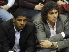 Kyrie Irving, left, has missed the Cavaliers' last three games with a concussion while Anderson Varejao is out indefinitely with a broken wrist.