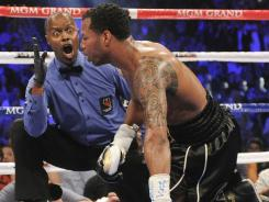Referee Kenny Bayless issues the count on Shane Mosley who was knocked down in the third round by Manny Pacquiao last May 7. Mosley got up and finished the fight, but lost a lopsided decision.