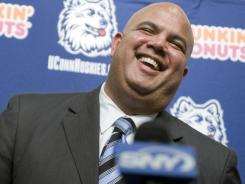 Warde Manuel smiles as he is introduced as the new athletic director for the University of Connecticut at a news conference in Storrs, Conn., Monday, Feb. 13, 2012.