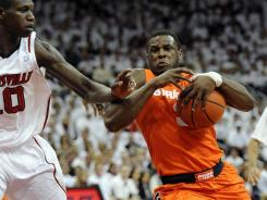 Syracuse Orange guard Dion Waiters (3) drives to the basket against Louisville Cardinals center Gorgui Dieng (10) during the first half at the KFC Yum! Center.