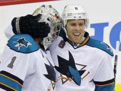 San Jose Sharks goalie Thomas Greiss (1) celebrates with Joe Pavelski (8) after beating the Washington Capitals at Verizon Center in D.C.
