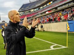 Former U.S. coach Bob Bradley applauds fans before the kick-off between the USA and Paraguay at LP Field in Nashville on March 29, 2011.