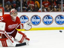 Detroit Red Wings goalie Joey MacDonald keeps his eye on the puck to make a save in the second period.