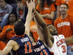 Clemson's Devin Booker (31) goes for a rebound against Virginia's Joe Harris (12) and Sammy Zeglinski during the second half in Clemson, S.C.
