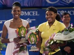 Venus, left, and Serena Williams helped the Washington Kastles go undefeated in 2011.