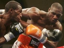 Paul Williams, right, takes a blow to the face from Erislandy Lara during their July bout. Williams won a majority decision, but the judges were suspended for incompetence.