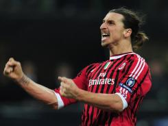 Zlatan Ibrahimovic of AC Milan celebrates his goal that helped Milan to a 4-0 victory over Arsenal at Stadio Giuseppe Meazza.