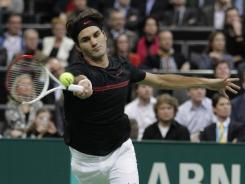 Roger Federer of Switzerland chases down a forehand during his victory against Nicolas Mahut of France.