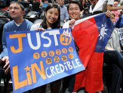 Fans show their support for Jeremy Lin of the New York Knicks.