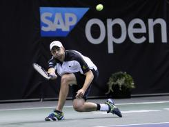 Andy Roddick of the USA reaches for a forehand during his three-set victory against Denis Kudla in the SAP Open,