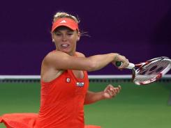 Caroline Wozniacki of Denmark raps a forehand during her loss to Lucie Safarova of the Czech Republic.