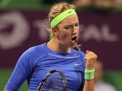 Victoria Azarenka of Belarus celebrates on her way to victory against Simona Halep of Romania.