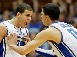 Austin Rivers, right, celebrates with teammate Seth Curry during the Blue Devils' victory over NC State.