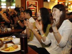 Fans at a sports bar in Taipei, Taiwan, watch Jeremy Lin play against the Kings. Taiwan is embracing the emerging Knicks' Taiwanese-American point guard as one of their own.