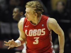 New Mexico Lobos guard Hugh Greenwood (3) reacts after making a three-pointer against San Diego State at Viejas Arena.